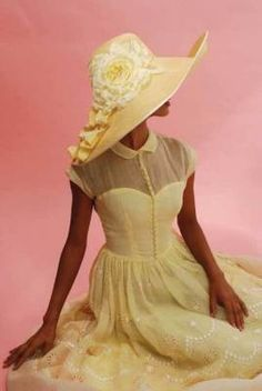 Oh!  This is so dreamy and old fashioned!  A lovely yellow batiste dress featuring Peter Pan collar and sweetheart neckline is accented with an outstanding flowery hat!