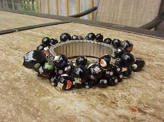 Glass bracelet with tone of dangles