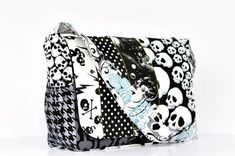 Punk Rock Skull Scraps Diaper Bag OOAK  Ready to by RockerByeBaby, $104.99. This is what I want when and if