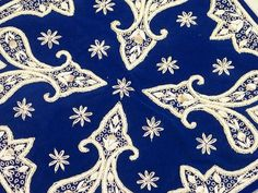 deep blue and white embroidery