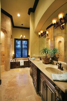 Light fixtures above sink, dark cabinets, white and almond colors mixed with natural hues