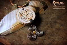 Double triskelion necklace by Neirahda on Etsy