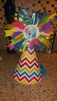 I made this for my daughters birthday. Used left over ribbon scraps, chevron gift wrap and covered a large paper party hat I got at Walmart. Colorful My little pony rainbow dash party hat. Rainbow Dash Party, Rainbow Birthday Party, 6th Birthday Parties, 4th Birthday, Birthday Ideas, My Little Pony Birthday Party, My Lil Pony, Party Hats, Gift Wrap