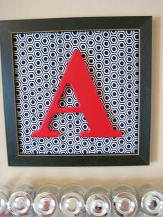Old photo frame, left over fabric, white letter spray painted red = matching monogrammed art!