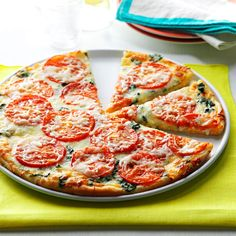 Spinach Pizza Recipe -This tasty pizza is so easy to prepare. My family, including my young daughter, loves it. What an easy way to make a delicious, veggie-filled meal! —Dawn Bartholomew, Raleigh, North Carolina