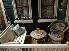 Even dollhouses have porches (RM) This one by Kathleen Holmes