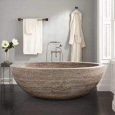 The sleek design of the Flavius Oval Tub creates an ideal showcase for the natural variations and striking colors of Silver Travertine. The natural beauty of this stone tub makes a splendid focal point for a master bath. Complete this look with a freestan Luxury Bathtub, Modern Bathtub, Bathroom Colors, Small Bathroom, Bathroom Ideas, Master Bathroom, Bathroom Inspo, Bathrooms, Bathroom Goals