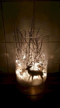 I took a vase, fake snow, a white reindeer, silver tree branches, decorations of white pearls and flowers as well as white Christmas lights and I created a winter wonderland to illuminate the dark days we live in Iceland. White Christmas Lights, Simple Christmas, Winter Christmas, Christmas Home, Christmas Crafts, Christmas Ornaments, Beautiful Christmas, Christmas Lanterns, Xmas Lights