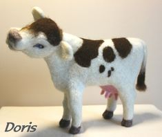 cute needle felted cow named Doris by Jane Strugnell