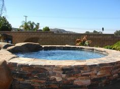 above ground pool with stone surround | Pool Tile Riverside Ca with Rustic Stone Hot Tub Surround and Stone ...