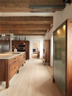 Blue Warehouse Apartment - Dinesen for the element of natural wood shades in the space