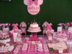 Amazing pink Minnie Mouse birthday party dessert table! See more party planning ideas at CatchMyParty.com!