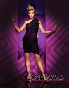 One-shoulder ruched illusion short sheath with over-sized dramatic flower accents on strap and side skirt.