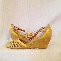 Like New BC Strappy Leather Wedge Lovely round-toe sandal with leather upper and faux grasscloth wedge in butter yellow. Like new; worn once for an hour or two. Cushy insole, too. BC Footwear  Shoes Wedges