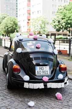Getaway car covered in pastel pom poms! Ashley Ludaescher Photography   http://bridalmusings.com/2014/11/chic-civil-wedding-berlin/