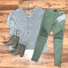 Today's #ootd features this super soft #sweater 😍 It has a strappy torso as well as a strappy back and looks great paired with these olive #motojeggings. We love this look for everyday wear! Stop by and shop our #newarrivals