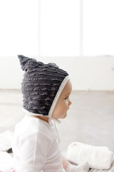 Make a super soft and whimsical pixie style bonnet with a little point at the top! Pick your favorite soft knit fabrics and sew up one of these lit...