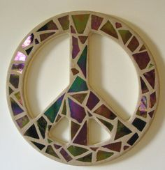 Mosaic Stained Glass Peace Sign -  This Peace Sign is made with hand cut Iridescent Purple Stained Glass. The glass reflects Gold and Green