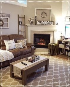 Living Room decor ideas - farmhouse style, muted browns and creams with fireplace.