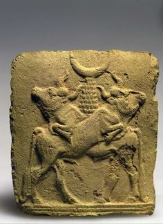 Plaque depicting a pair of bulls, with a crescent symbolizing the moon god Sin atop a mountain-like pedestal on their backs. Old Babylonian Period, first half of the 2nd millennium BCE . Israel Museum, Jerusalem