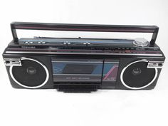 Retro Toshiba Rt-8016 boombox ghetto blaster radio pink blue and black vintage portable stereo cassette player.
