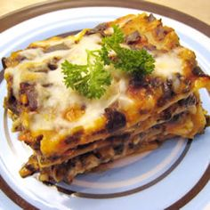Spinach with three types of cheese and herbs, layered with red sauce and noodles.