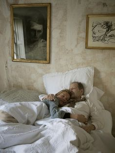 Kate Moss comforts artist Lucian Freud while he rests after being in an accident. Photograph by David Dawson - 2009.  London's Pallant House Gallery features photographs by David Dawson, who was Freud's model and studio assistant for 20 years. The show features some of Freud's key paintings alongside Dawson's photographs of the artist at work in his studio. http://lightbox.time.com/2012/02/07/the-life-of-lucian-freud/#1