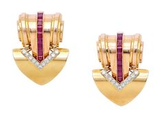 A Pair of Retro Ruby and Diamond Double-Clip Brooches, circa 1935  Of odeonesque design, the coiled and fluted cylinders accented by channels of square rubies, to undulating mitre-shaped terminals enhanced with chevron lines of round diamonds, mounted in platinum and 14k pink and yellow gold