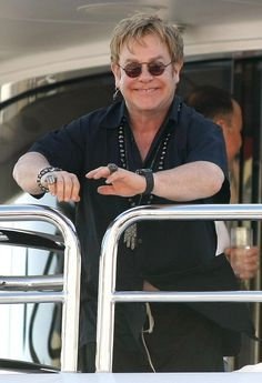 Elton John and David Furnish arriving at Club 55 and doing a little shopping at Louis Vuitton and Dolce And Gabbana before heading back to a yacht and hanging out with friends in Saint Tropez, France.