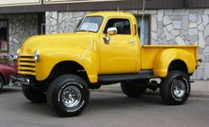 lifted Chevy Advanced Design pickup truck with a tilt forward nose