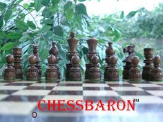 Hand Craved Sheesham wood Chess Pieces! King Height 4 inch, Base Diameter 1.25 inch The carving is bespoke and individual - an amazing set for this price. Lines on the set are irregular, some bishops have smiles, some don't. A great chess set with a real theme along with strong Staunton influence. Get all your chess needs at ChessBaron.co.uk #chesssets