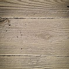 sandblasted timber board to accentuate wood pattern, formed concrete