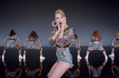 Part 2: Taylor Swift Shake It Off video depicting Caucasian women in ballerina outfits, dancing more elegantly than dancers here, who use more provacative movements and are mostly African American women. In ballerina part, dancers faces are shown, here the dancer's faces are not shown and only their backside or thighs are shown here.