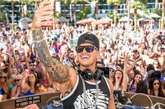 Celebrity Photos 2016:     DJ Pauly D spins at the Rehab Pool Party in Las Vegas on April 3, 2016.