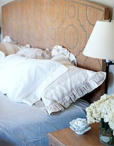 That is a pretty amazing headboard! Would be a good way to spice up a old wood headboard found at a yard sale/thrift store...