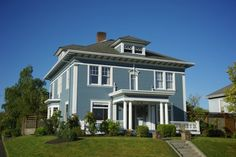 Farmhouse mansion in, Tacoma, WA 98403. Especially like the pillars around the porch.