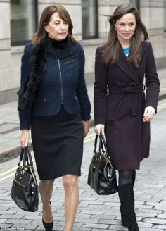 Classic style: Pippa and Carole looked rather serious as they left the gallery holding almost identical handbags