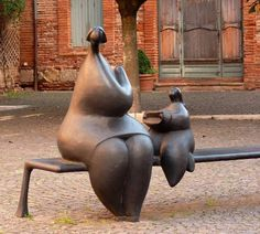 Only 'Oldies' would understand what they are doing in this sculpture...... I remember having to do this for my Mum's knitting wool ,,,lol,,,