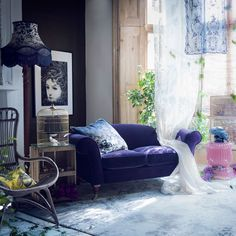 Watercolour living room. I could never achieve this because I have 2 insane children, but i love the shutters softened by draped fabric, the use of a gold cage as decoration, and the casual bunch of stunning dark purple flowers.  Scary owl tho.