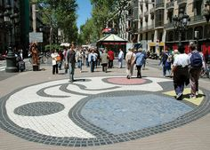 Barcelona's Top 10 : La Rambla - Miró Mosaic    Splashed on the walkway on La Rambla is a colourful pavement mosaic by Catalan artist Joan Miró. His signature abstract shapes and primary colours unfold at your feet.