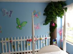 "Butterfly Garden Girls Room, This butterfly garden themed girls room features blue walls, poly vinyl fencing with flowers, and a ""tree"" with storage shelves! A lighted trellis hangs above the bed, with butterflys, catepillars, lady bugs all adorning the walls., Girls Rooms Design"