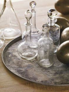 A collection of antique French crystal decanters and an antique silver tray are from Martin.