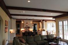 Adding some faux wood ceiling beams gave the room more character.