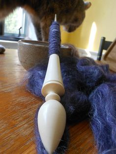 Lara:  Holly Russian-style spindle from Texas Jeans.  22g, my first supported spindle!