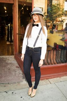 White button-down paired with a bow tie and suspenders
