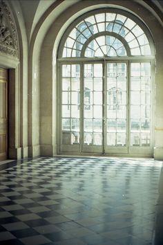 versailles checkerboard black white circular windows