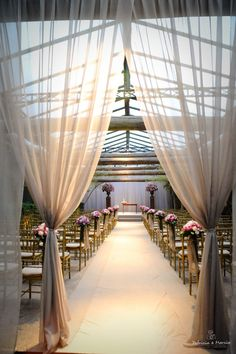 Love the curtains, such an elegant entrance to the ceremony.