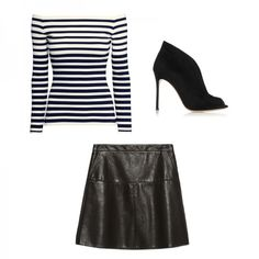 A faux leather mini skirt looks ultra-sexy with little black booties.