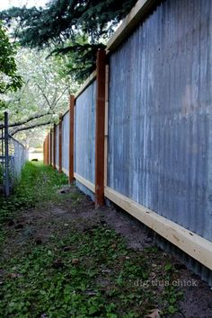 corrugated metal fence out of reclaimed materials by lorraine
