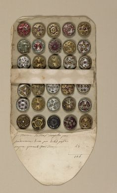 Folding envelope, or book, made of paper; used as a sales case for thirty circular buttons, late 18th century, French school